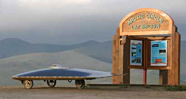Marcelo and his solar car Xof1 at the Arctic Circle