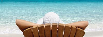 man_resting_on_beach_wallpaper